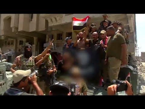 Islamischer Staat geschlagen: Irakische Streitkräfte feiern Rückeroberung von Mossul