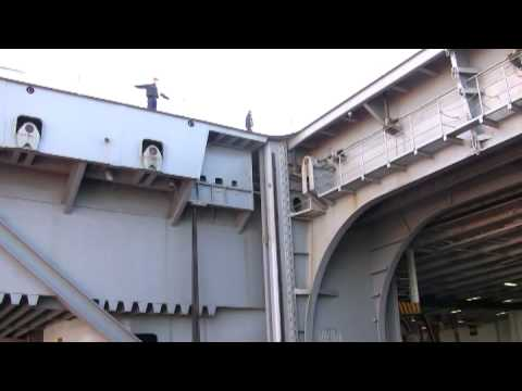 riding aircraft carrier's elevators