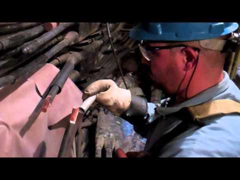Con Edison Crew Repair Electrical Equipment in NYC Manhole