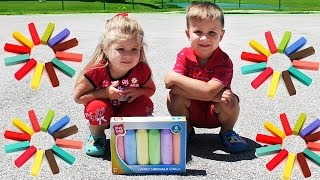 Diana and Roma draw with giant crayons
