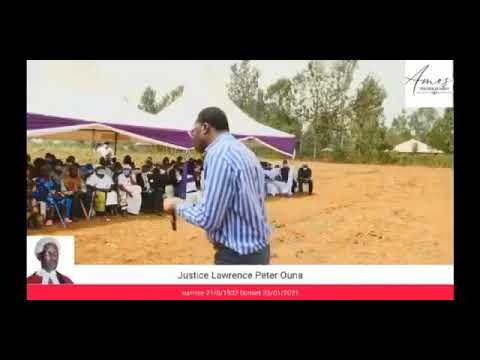Staggering Supreme Court Judge Smokin Wanjala speaking at a burial ceremony