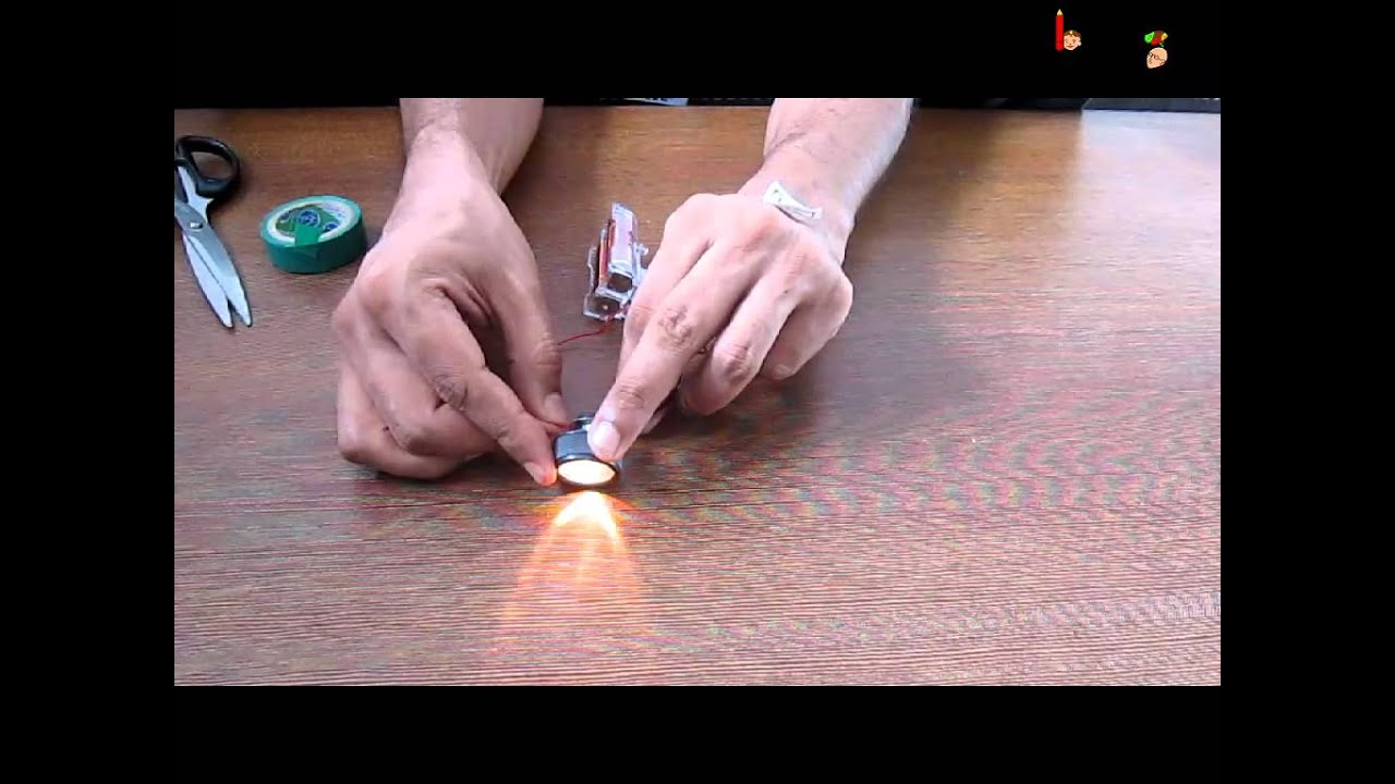 hight resolution of science electricity experiment with torch and circuit english