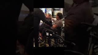 Old black lady fights lady in wheel chair