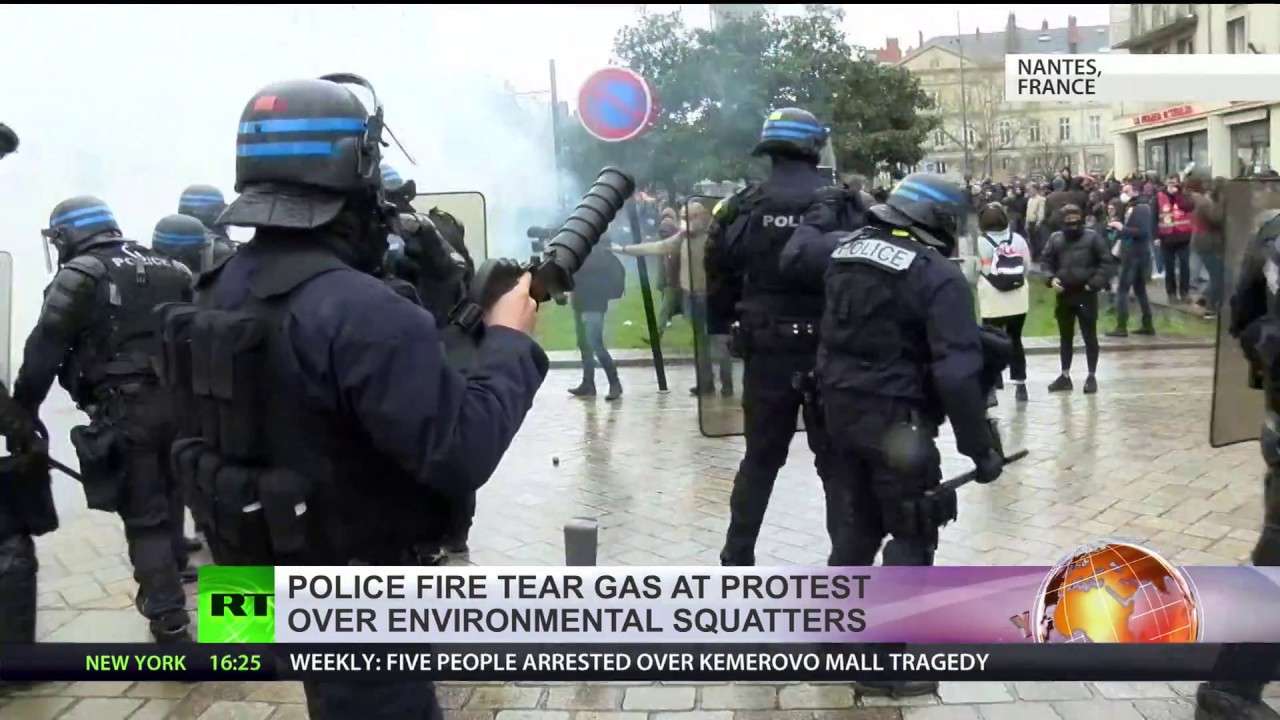 Police fire water cannon & tear gas against protesters during a demonstration in French Nantes