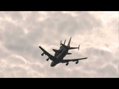 Space Shuttle Discovery over Jefferson Memorial and Joint Base Andrews