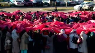 Ahmadiyya Muslims in Calgary create giant human Poppy to honour Veterans