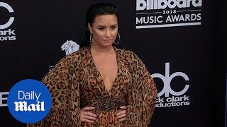 Hear her roar! Demi Lovato dons cheetah print at Billboards - Daily Mail