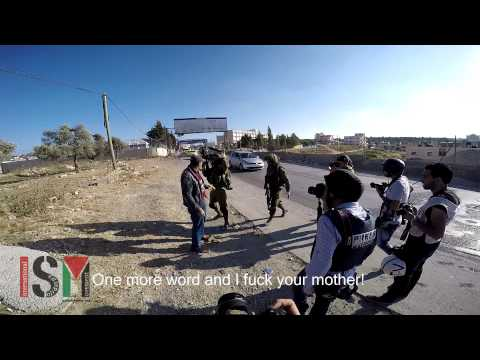 Israeli Soldiers Attack Palestinian Journalist & Beat a Man with Rifle