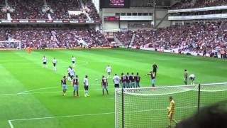 West Ham fan invades pitch and takes free kick
