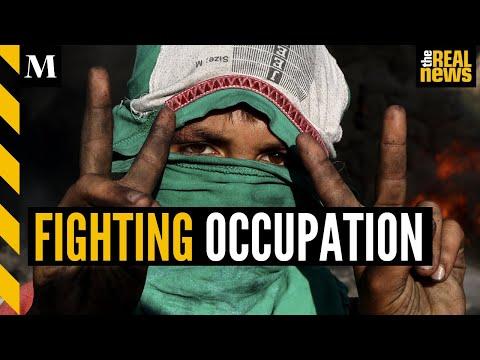 Palestinian villagers fight against illegal Israeli settlements in Beita