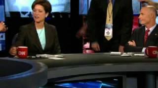 Alex Sink uses mobile device duringdebate