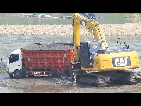 Excavator CAT 320D Digging Loading Sand From The River Quarry