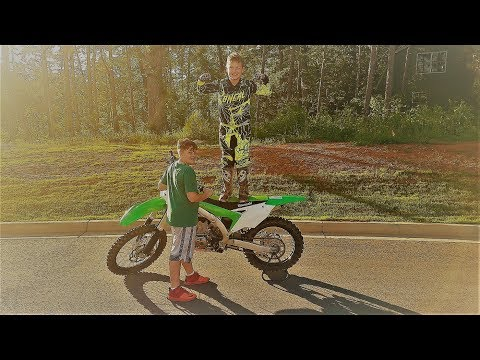 kid wants to ride the KX 450 and top speeds on both bikes!!!