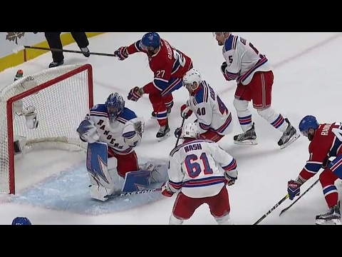 Who needs a stick? Lundqvist makes several saves without one late in the game