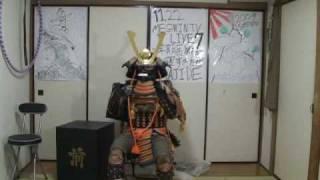 The samurai bought the armor. 侍が甲冑を初めて買った thumbnail