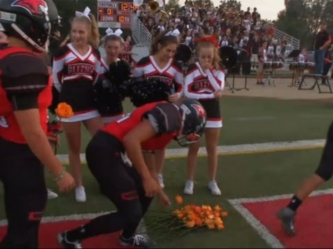 Football Team Gives Roses to Ill Cheerleader