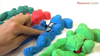 Toy car in bunnies from kinetic sand