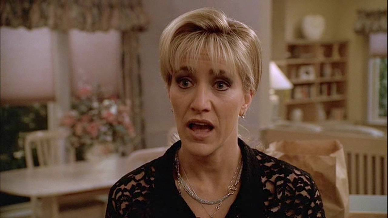 carmela soprano is giving father phil intintola a lecture.