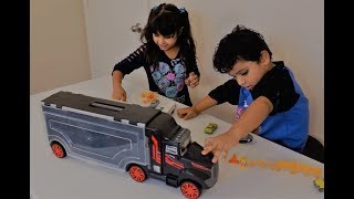 Am toys show playing cars and a big truck