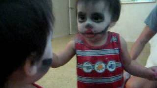 Baby Scares himself in the mirror.