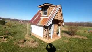 i thought that we should have a cool playhouse so i build one. it was build 100 percent out of reused and salvaged materials, i had