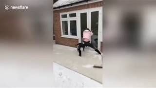 Woman slips on ice trying to open back door