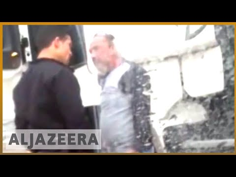 Israeli policeman caught on video beating Palestinian truck driver