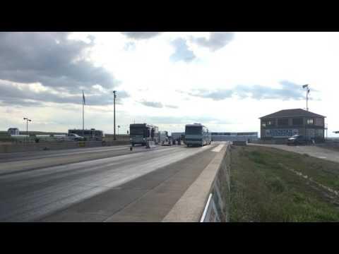 Drag Racing Motorhomes with Loaded Race Trailers