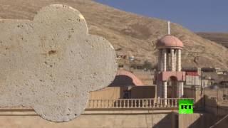 ترميم الصليب على كنيسة مار كوركيس في بعشيقة