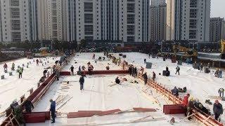 Watch workers rush to build China's coronavirus hospital