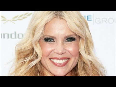 Melinda Messenger's ample assets risk overspill in seriously low-cut dress
