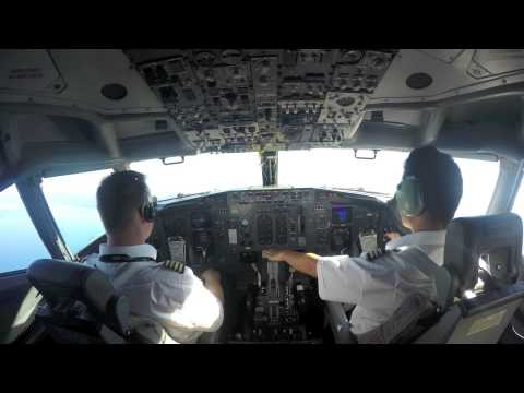Cargo plane loading and cockpit on takeoff - time lapse