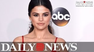 Selena Gomez poses in towel and a thong after spotted smooching The Weeknd