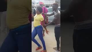 Roadside Dancer Gets HOT SLAPS From Lady... After Rough-Handling & Disrespecting Her!!!