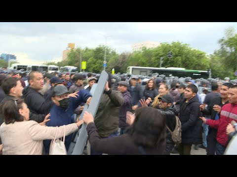 Police and protesters clash as Kazakhs vote for new leader | AFP
