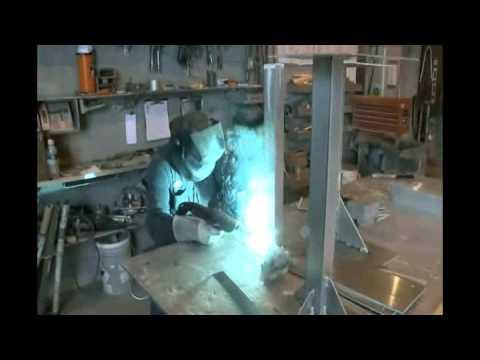 Marine welder working on deck equipment