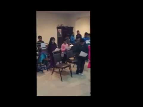 Aramaic Project-Part 23. First Communion children learn to sing Our Father in Syriac.