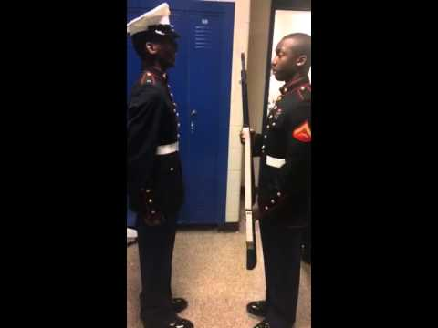 MCJROTC cadet gets inspected by Marine Corps Lance Corporal