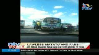 Gor Mahia branded fans hang on matatu from Nairobi to Thika