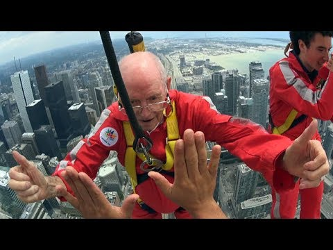 97-year-old takes a walk outside CN Tower