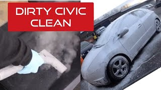 Cleaning a dirty Honda Civic ready for sale.