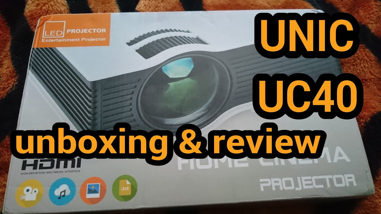 UNIC UC40 HD LED Projector unboxing and video sample - YouTube