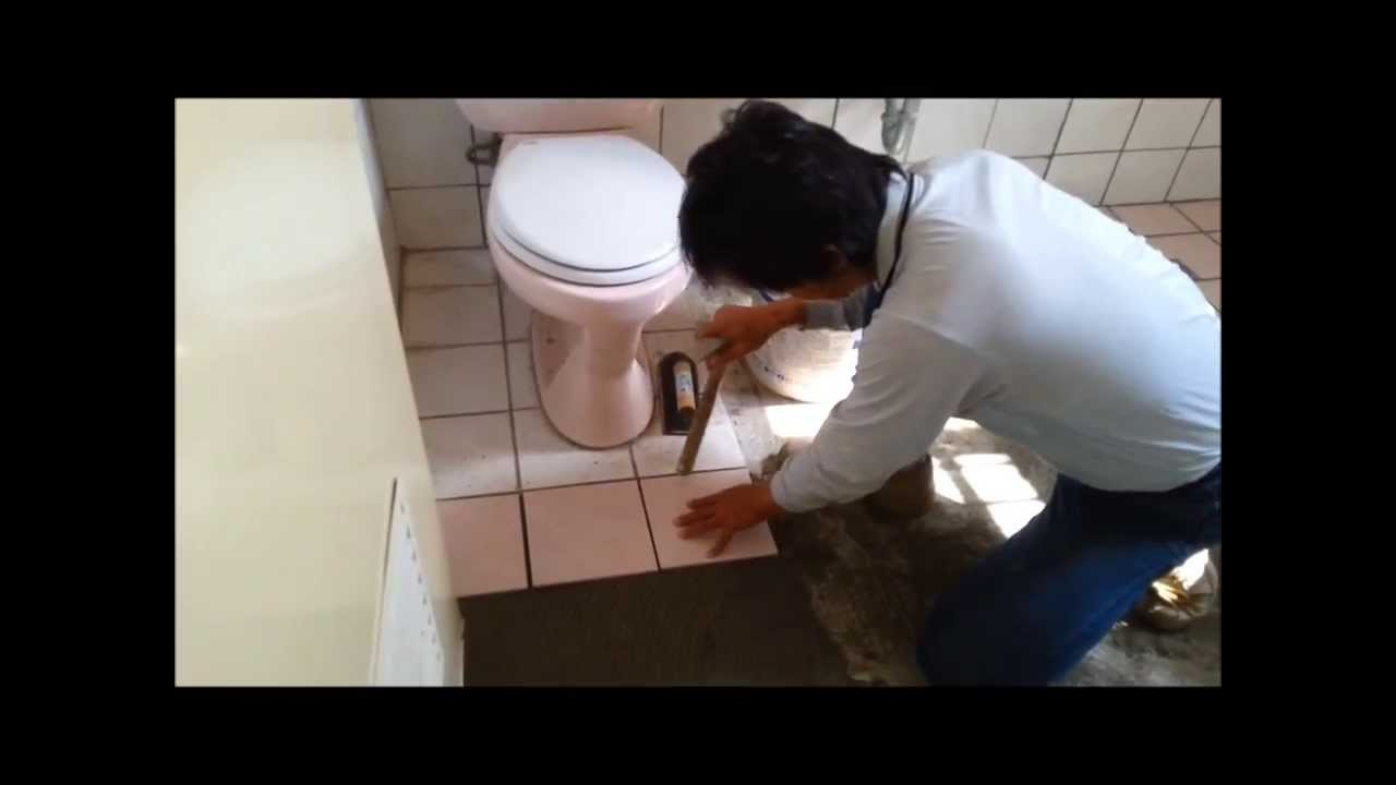 Tile Installation in Bathroom on Concrete Walls and Floors
