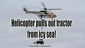 Kopteri nostaa traktorin