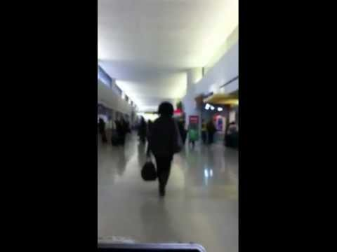 Golf cart transport at NEWARK INTERNATIONAL AIRPORT Listen to driver