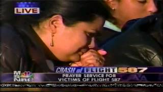 Milly Quezada sings at Flight 587 Prayer Service