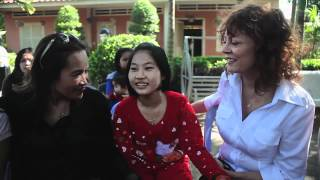 Susan Sarandon Meets Young Girl in Cambodia