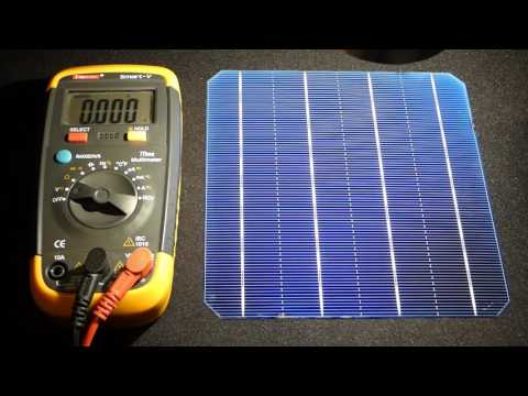 Multimeter testing my new solar cells indoor