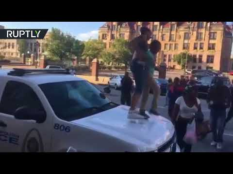 Protesters hit St. Louis police car after officer acquitted of black driver's murder