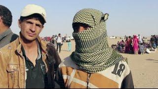 أخبار عربية : الموصليون ينزحون إلى سوريا هربا من بطش داعش